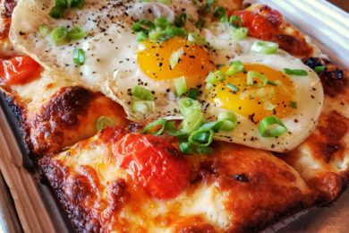 Brunch Pizza with sunny side up eggs on top